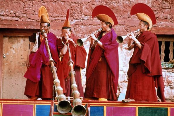 Tibet,Ta Gong Monastery,Lamas playing horns during Cham ceremony | Musical Instruments