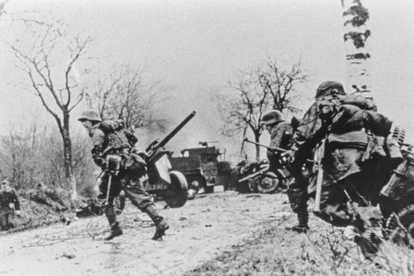 The German attack begins, SS infantry advancing, December 1944