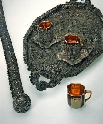Filigree belt and tray with cups, 19th century BCE