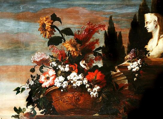 Flowers in a basin and a sphinx