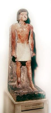 Statue of a standing man with a white shenti