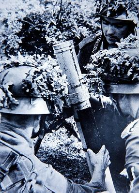 WW2 German 81mm mortar crew in action in the bocage country of Normandy, 1944