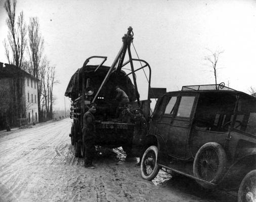 British soldiers towing a motor vehicle in Italy during WWI