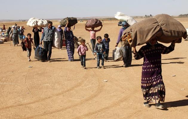 Refugees Flee Kobane As IS Forces Battle Kurdish Resistance | Conflicts: Syria