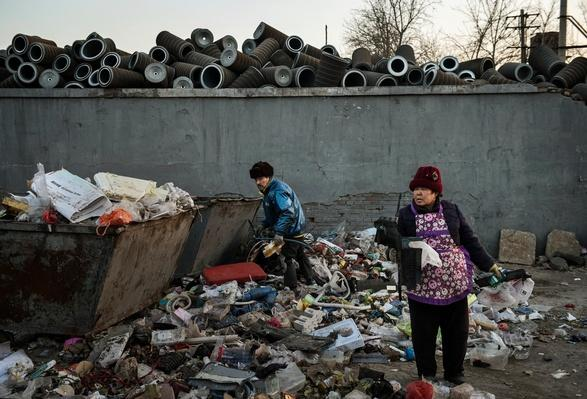 Migrant Community Within China's Capital Makes Livelihood by Recycling City's Scrap | Human Impact on the Physical Environment | Geography