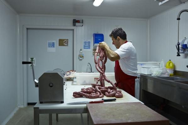 Butcher Making Sausages at Slaughterhouse | Earth's Resources