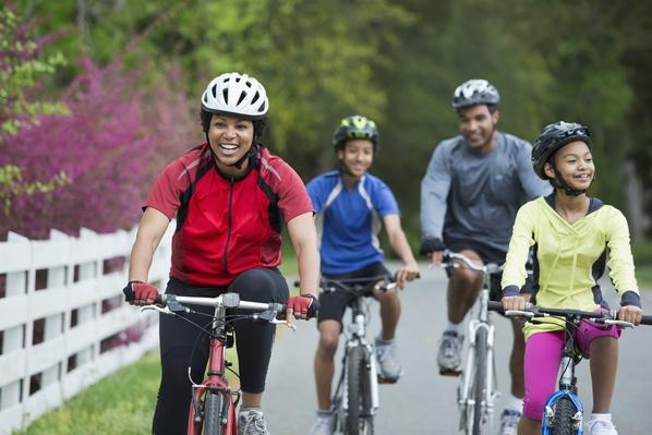 Black family riding bicycles together | Health and Nutrition