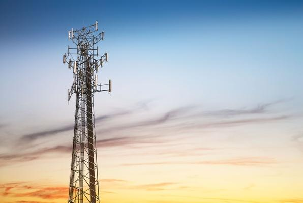Cellular tower at sunset | The Evolution of the Mobile Phone