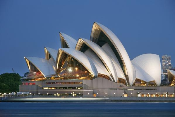 Sydney Opera House across water at dusk | Monuments and Buildings