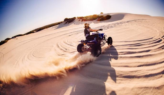 Professional Quad Biker Kicking Up Sand on a Dune | Earth's Surface