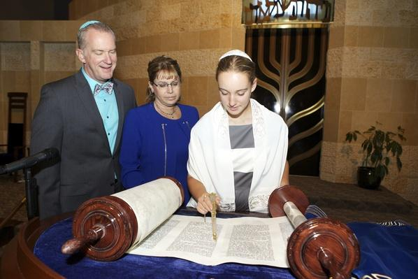 Bat Mitzvah Girl Reading the Torah with Her Parents | World Religions: Judaism