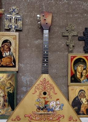 Display case with sacred images, crucifixes and balalaika, Moscow, Russia | Musical Instruments
