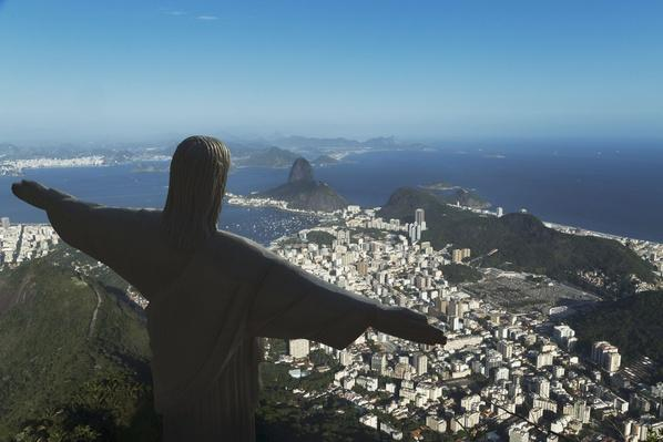 Christ the Redeemer statue and the coastline, Rio De Janeiro, Brazil | World Religions: Christianity