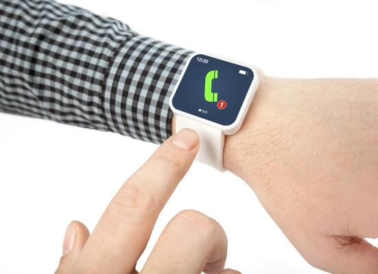 male hands with smartwatch a phone call on the screen | The Evolution of the Mobile Phone