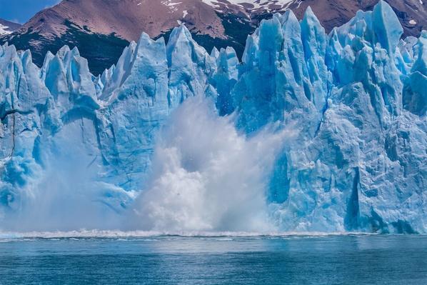 A Calving Iceberg Falls - Perito Moreno Glacier   Earth's Surface