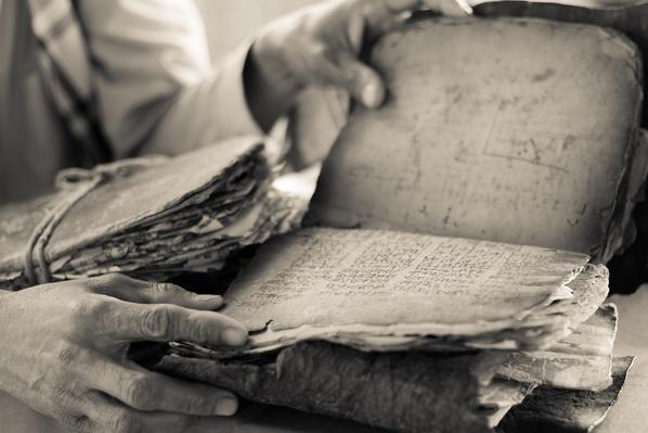 Man reading in Hindu scriptures - Nepal | World Religions: Hinduism