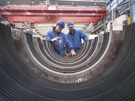 Engineers Inspecting Turbine Housing | Earth's Resources