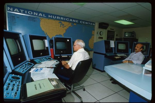 Two Men Look At A Computer Screen At The National Hurricane Center | History of the Computer