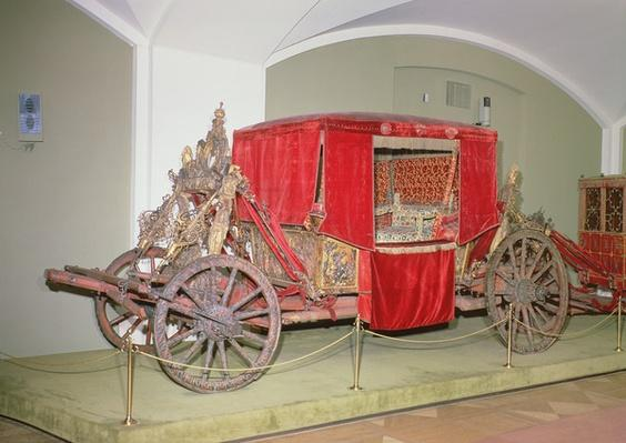 English carriage, carved wood, painted and gilt decoration with velvet curtains