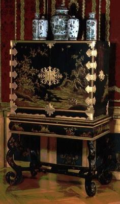 Decorated cabinet on stand, attributed to Gerard Dagly, Berlin lacquer master renowned as an Oriental copyist, c.1700