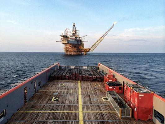 Oil Platform Seen From Main Deck of Platform Supply Vessel | Earth's Resources