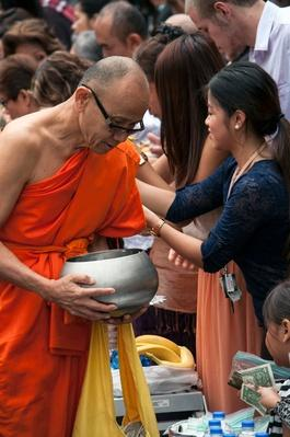 Asians Paying Tribute to a Buddhist Monk | World Religions: Buddhism