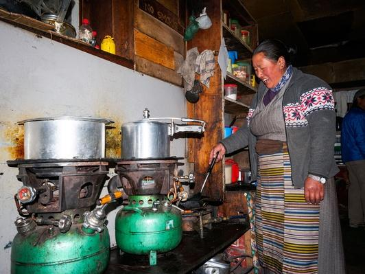 Sherpa Woman Cooking on Kerosene Burners in Lodge | Earth's Resources