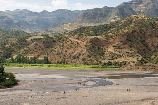 People Walking Through a Riverbed to Ziya Market | Earth's Surface