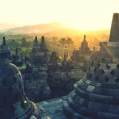 Stupas At Borobudur Temple During Sunset | World Religions: Buddhism