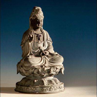 Bodhisattva Statue Against Blue Background | World Religions: Buddhism