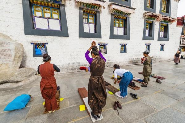 China, Tibet, Lhasa, Tibetan pilgrims in Barkhor Square, outside Jokhang Temple | World Religions: Buddhism