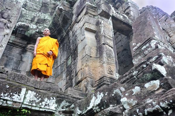 Monk at Bayon temple at Angkor Thom, Cambodia | World Religions: Buddhism