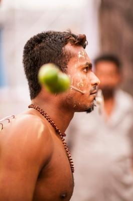 Piercing spear with lime in procession | World Religions: Hinduism