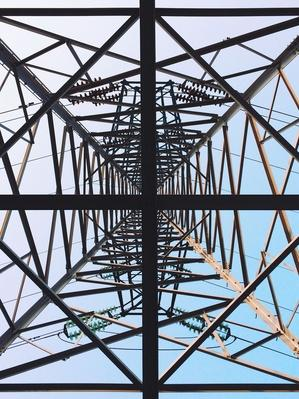 Directly Below Shot of Electricity Pylon Against Clear Sky | Earth's Resources