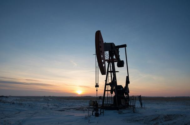 An Oil Drilling Rig and Pumpjack in the Canadian Oil Fields | Earth's Resources