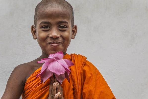 Buddhist boy with lotus flower | World Religions: Buddhism