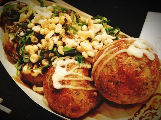Close-Up Of Okonomiyaki Served On Table | Exploring International Cuisine