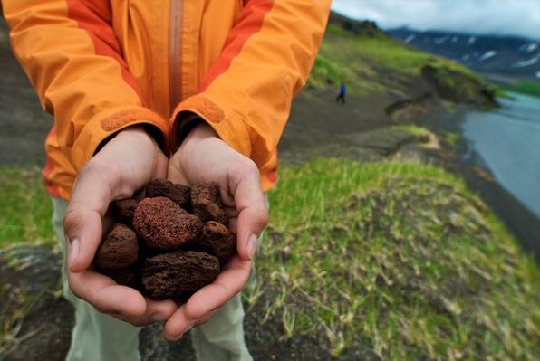 Person Holds Up a Handful of Lava Rock, Alaska | Earth's Surface
