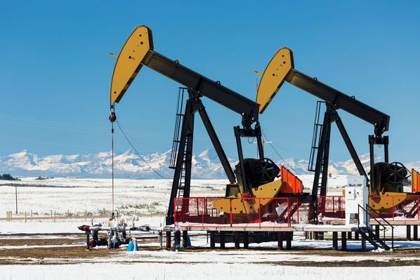 Pump Jacks in a Snow Covered Field | Earth's Resources