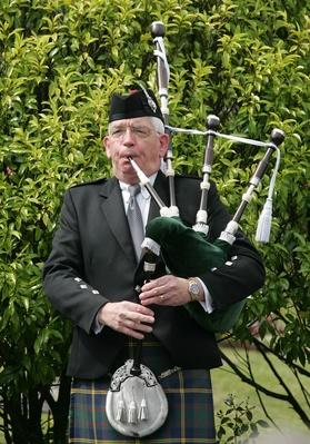 A Scottish man plays the bagpipes to start the mem | Musical Instruments