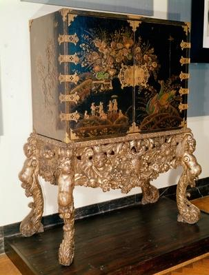 Black and gold lacquer cabinet on carved and silvered stand, Charles II period, 1649-85