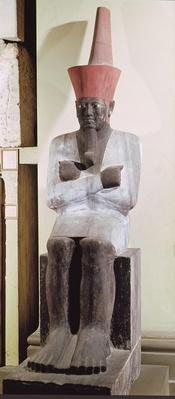 Statue of Mentuhotep II, enthroned and wearing the red crown of Lower Egypt, taken from the Mortuary Temple of Mentuhotep II, at Deir el-Bahri, Middle Kingdom