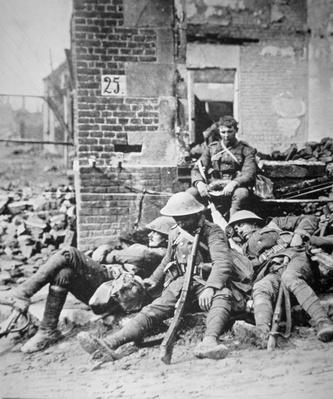 British troops resting after pushing Germans from a town during the Allied offensive in southwest Flanders, August 1917