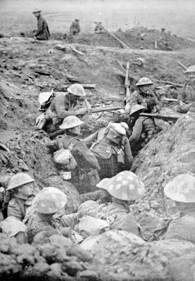 British troops in crude roughly-dug trenches await the signal to attack in the Third Battle of Ypres, 30th October 1917