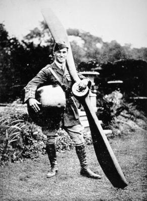British air ace Albert Ball holding trophies from his 43rd victory, c.1917
