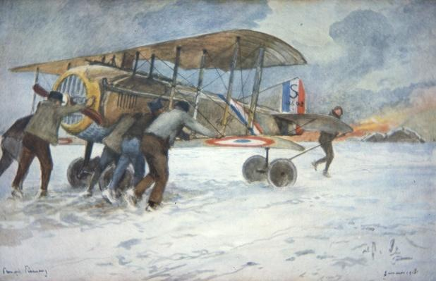 Ground crew and pilot manhandle a French Spad fighter through the snow to a hangar, January 1918