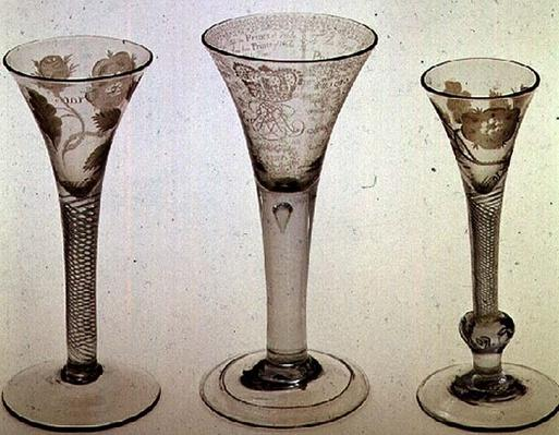 Jacobite glassware: left to right: wine glass with trumpet bowl, 1745; Amen glass, James VIII of Scotland, 1725; Wine glass with trumpet bowl, 1750