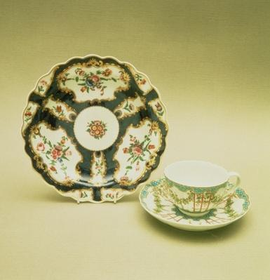 Worcester porcelain plate with scale blue decoration, 1768; teacup and saucer with hop trellis-work decoration, c.1770