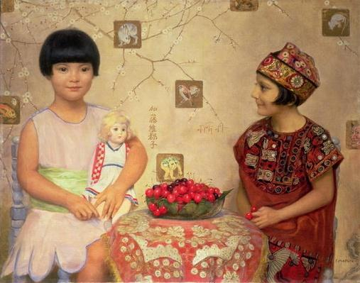 Two children with a bowl of cherries