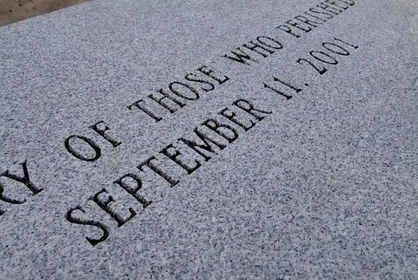 Close-up of granite bench dedicated to victims of September 11th | 9/11: We Will Never Forget